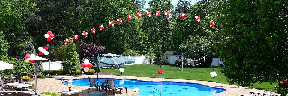 Cluster line arch for backyard graduation pool party